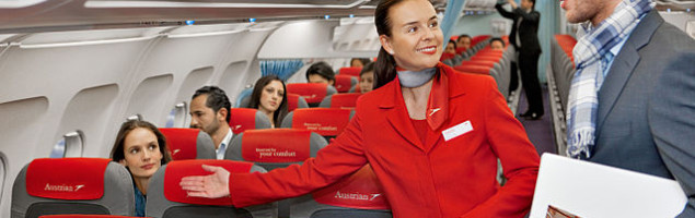 640px-Austrian_Airlines_flight_attendant_and_passenger