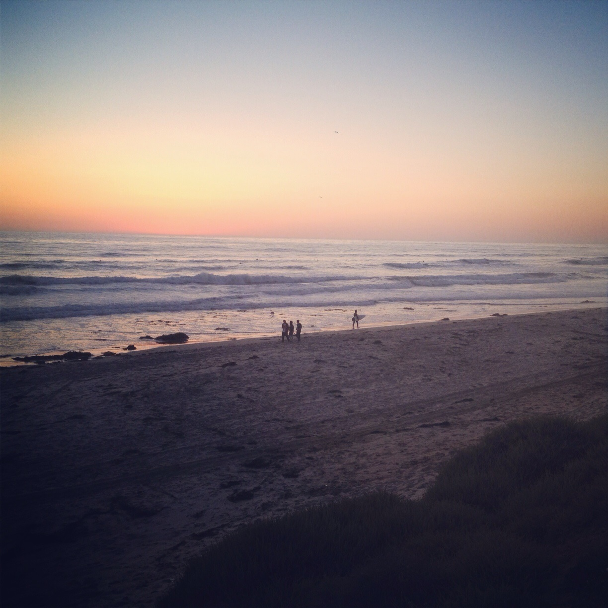 Watching the sun set at the beach is one of best free things to do in San Diego