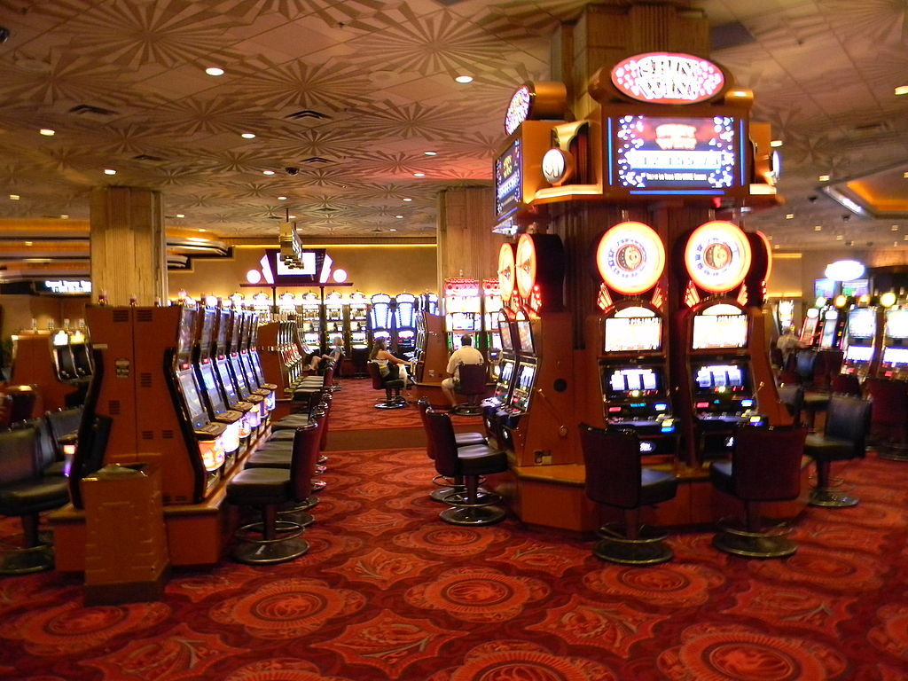 Slot machines are one of the most common games can you find in Vegas ... photo by CC user Laslovarga on wikimedia