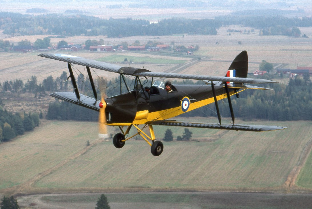 Flying a Tiger Moth is one of the more unique experiences you can have in the UK ... photo by CC user Towpilot on wikipedia.org